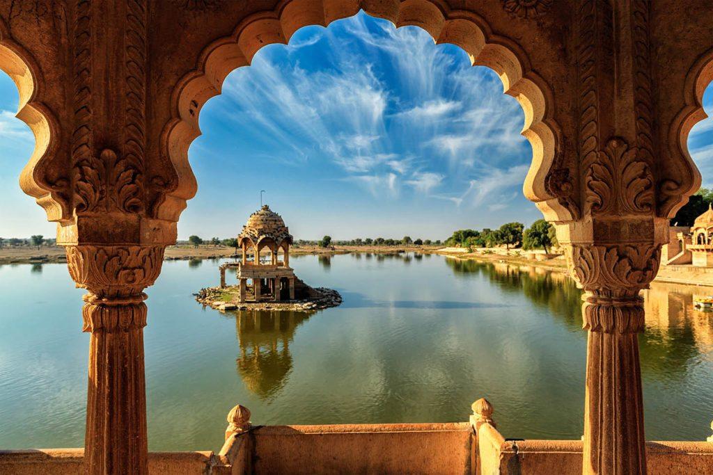 Indian landmark Gadi Sagar - artificial lake view through arch.